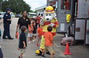 Sparky the Fire Dog greeting children
