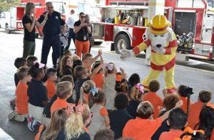 Sparky the Fire Dog talking to a group of children